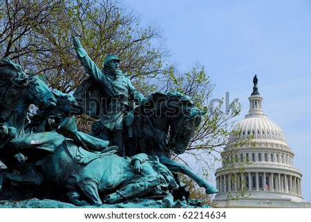 The Age of Hero of Civil War Memorial and Capitol Hill Building dome in Washington DC - stock photo