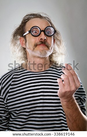 the aged man with crazy expressive face on round glasses  in a sailor isolated on the white background