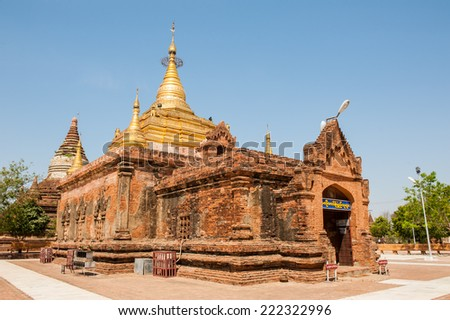 The Ahlodawpyae  Paya (pagoda) in Bagan, Myanmar. Located between the new Bagan and the village of Bagan, this temple is style of tradition between the first period and the intermediate period. - stock photo