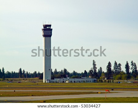 The Air Traffic Control Tower of a Modern Airport - stock photo