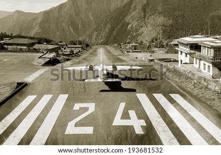 The aircraft on the runway of the Tenzing-Hillary airport Lukla - Nepal, Himalayas (stylized retro) - stock photo