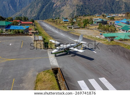 The aircraft on the runway of the Tenzing-Hillary airport of Lukla village - Nepal, Himalayas - stock photo