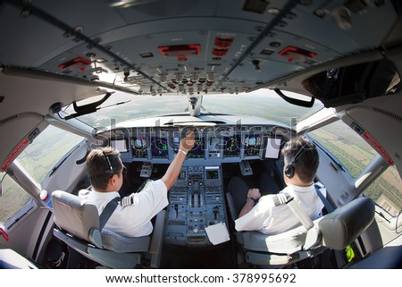 The Aircraft pilots at work. Take-off run was extremely short. And the speedy climb. View from the cockpit.  - stock photo