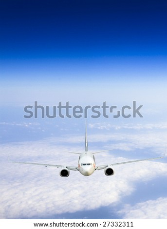 the airplane on  the blue sky background. - stock photo