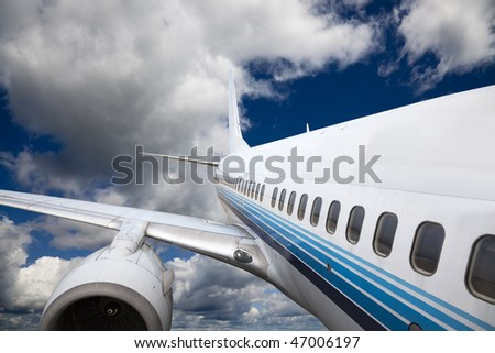 the airplane with the blue sky background. - stock photo
