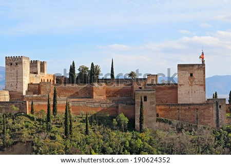 The Alcazaba fortifications of the Alhambra against the blue skies of Granada, Spain