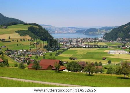 The Alps mountains in Switzerland on Mount Stastenhorn near Lucerne showing lake, and towns - stock photo
