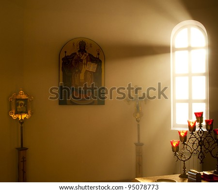 The altar is lit by the early morning sunlight. Village Dubki, Saratov region. - stock photo