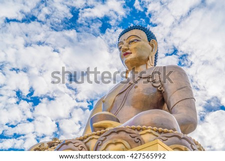 the amazing bronze statue of buddha  in the capital city of thimphu in isolated kingdom of bhutan. - stock photo