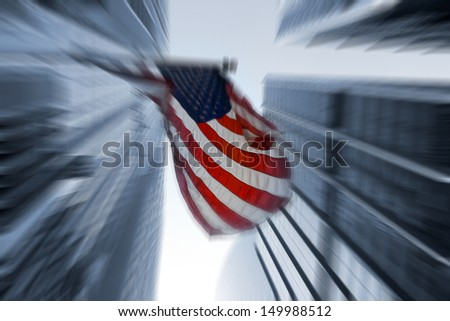 The American flag flutters in the wind - stock photo