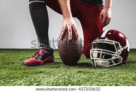 The american football player with ball