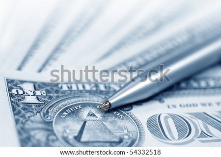 The American money dollars. Bundle of bank notes  and pen