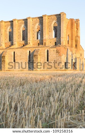 The ancient abbey of San Galgano, founded in 1224, in the province of Siena in Tuscany, Italy in evening light.