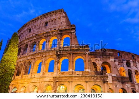 The ancient Colosseum at twilight in Rome, Italy