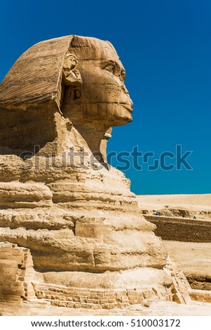 The ancient Egyptian sculpture of sphinx - creature with a lion's body and a human head in profile in Giza, Cairo, Egypt