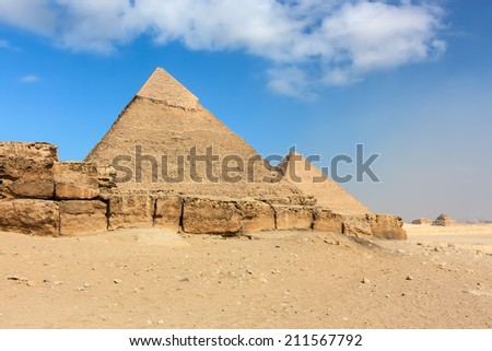 The ancient Great (Cheops) and 2nd Pyramids above the city of Cairo, Egypt - stock photo