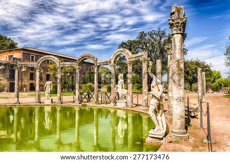 The Ancient Pool called Canopus, surrounded by greek sculptures in Villa Adriana (Hadrian's Villa), Tivoli, Italy - stock photo