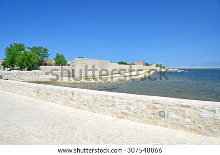 the ancient roman town walls of the island town of Nin, near to Zadar, Croatia - stock photo