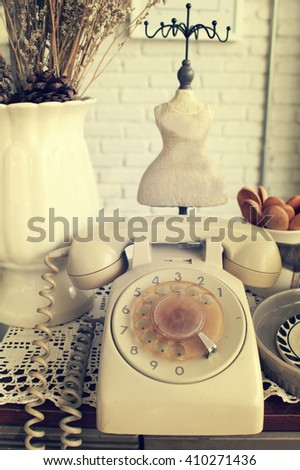 The ancient telephone version in retro style - stock photo