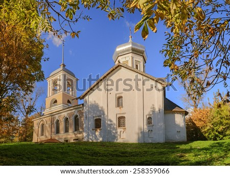 The ancient Trinity Church with the bell tower in Veliky Novgorod - stock photo