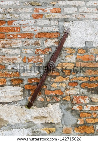 The ancient wall of the house after repairs - Venice, Italy