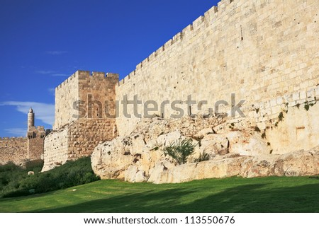 The ancient walls of the eternal Jerusalem and the Tower of David. Beautiful sunset - stock photo