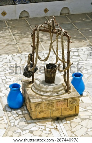 The ancient well in the courtyard of the mufti in Sidi Bou Said, Tunisia - stock photo