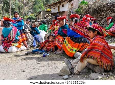 THE ANDES, PERU - MAY 30, 2012: Quechua family in a village in the mountains of The Andes over Ollantaytambo, Peru - stock photo