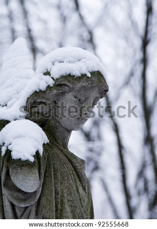 The Angel in winter - stock photo