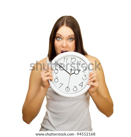 The angry girl bites clock , on a white background - stock photo