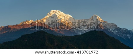 The Annapurna South and the Hiunchuli at sunrise panoramic view, Nepal - stock photo
