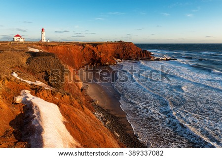 The Anse-a -la-Cabane lighthouse at sunset on Havre Aubert Island, Quebec, Canada