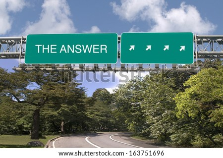 The Answer written on overhead highway sign - stock photo