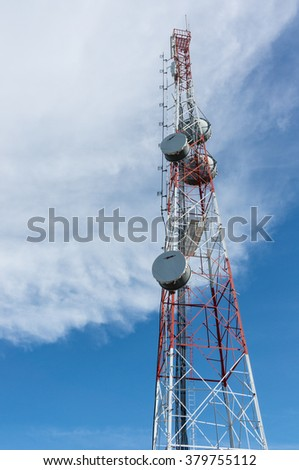 The antenna signal telecommunication tower with blue sky and cloud