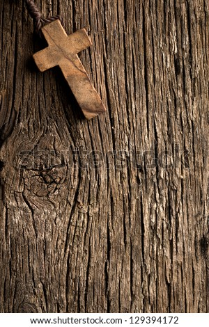 the antigue wooden cross on old wooden background - stock photo