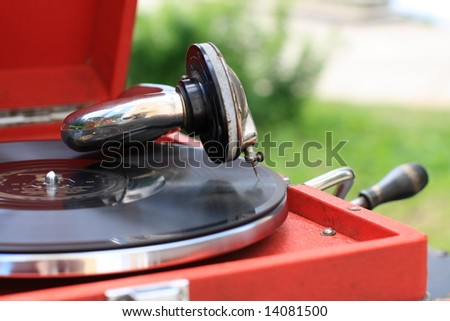 The antiquarian portable gramophone with disc, outdoor - stock photo