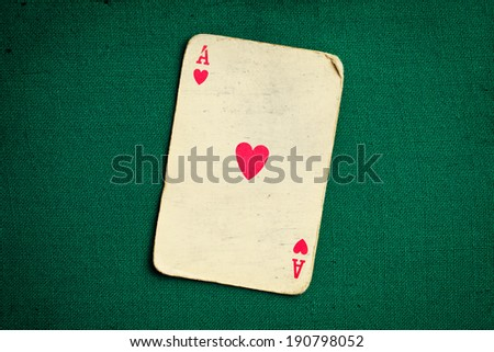the antique card on green casino table - stock photo