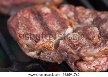 The appetizing ribeye steak  prepares on a grill lattice - stock photo