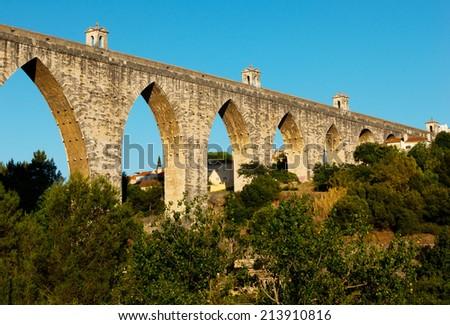 """The Aqueduct Aguas Livres (Portuguese: Aqueduto das Aguas Livres """"Aqueduct of the Free Waters"""") is a historic aqueduct in the city of Lisbon, Portugal - stock photo"""