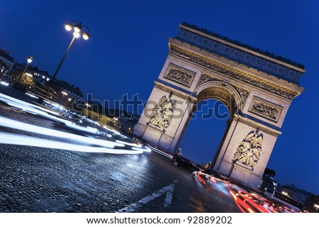 """the """"Arc de Triomphe"""" by night, Paris France in autumn - stock photo"""