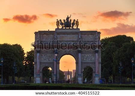 The Arc de Triomphe du Carrousel at sunset in Paris, France - stock photo