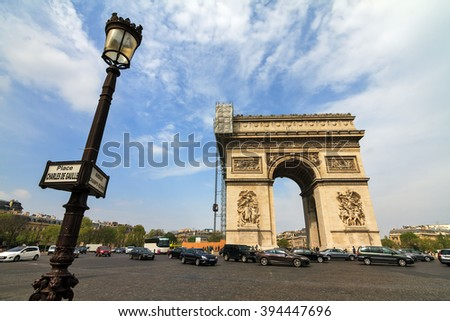 The Arc du Triomphe at the Place de Gaulle in Paris, France - stock photo
