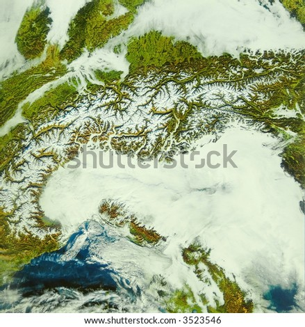 The arc of Alps framed by clouds - stock photo