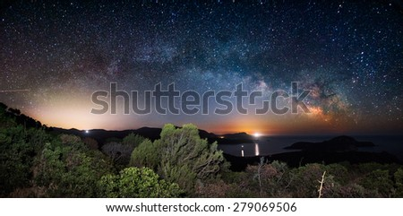 The arc of the Milky Way in a panoramic night view - stock photo