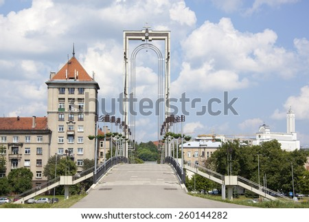 The arch of Independence Bridge for pedestrians and bicycles only in Kaunas city (Lithuania). - stock photo