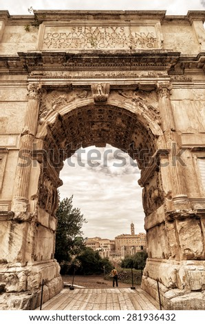 The Arch of Titus at the Roman Forum in Rome, Italy - stock photo