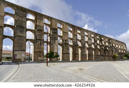 The arches of the Roman Aqueduct Aqueduto da Amoreira in Elvas in Portugal - stock photo
