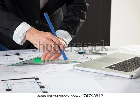 The Architect is finishing the House construction Plan. - stock photo