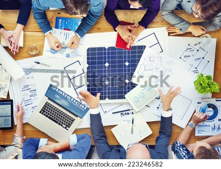 The Architects Brainstorming with Blueprint - stock photo