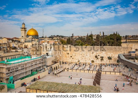 The area before the greatest a Judaism shrine. The Western Wall of the Temple prepares for an evening prayer. Autumn holiday of Sukkot